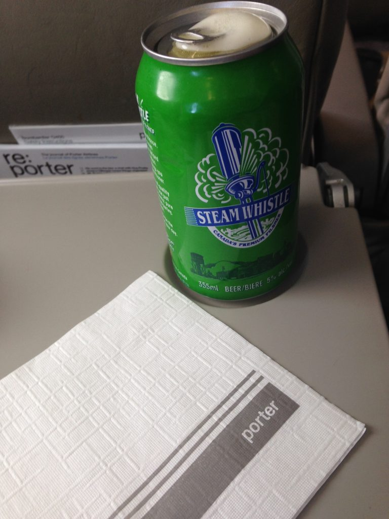 Complimentary beer or wine or pop or coffee/tea from Porter Airlines